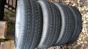 4 pneus avec mag Oldsmobile alero