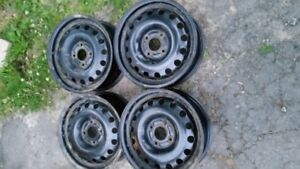 FOUR 15 INCH FORD STEEL WHEELS 4 BOLT WITH 108MM BOLT PATTERN