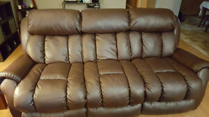 Two large brown leather couches 3 years old