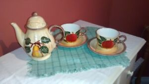 Fruit pattern ceramic coffee set.