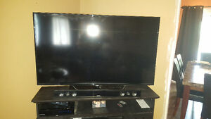 "58"" Smart TV and wireless surround soundbar"