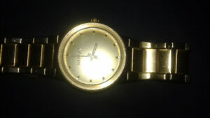 Nixon the Canon gold watch