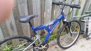supercycle xti 21 spd mountain bike,juicy shocks Kingston Kingston Area image 1