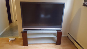 Sony lcd projection tv and stand ..glass and wood