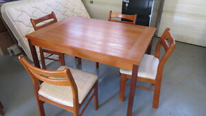 Teak dining set expands to seat 8