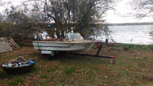Excellent running motor with boat and trailer.