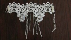 White Lace and Crystal Bridal/Prom Cuff Bracelets adjustalable.