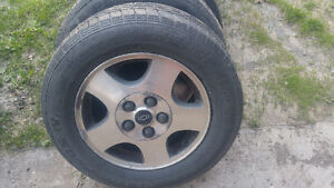 Tires and rims off of a 2003 malibu