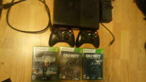 Latest Model Xbox 360 w/ 2 controllers and games