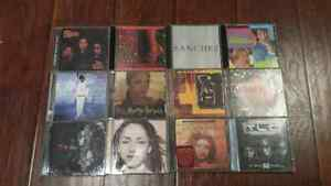 Twelve CDs in cases.  Various musicians