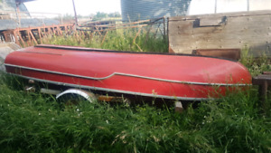 Wooden Boat and bumper pull trailer.