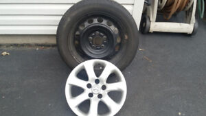 4 tires with rims and wheel covers