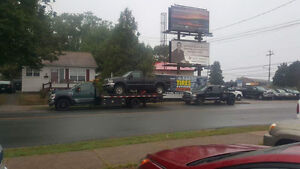 24 HOUR LOCAL AND LONG DISTANCE TOWING