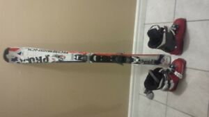 kids rossignol 120 skiis and salomon boots 23 276