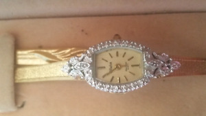 Gold diamond-encrusted watch