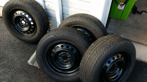 4 195/65/15 Toyota Corolla Factory Rims and All Season Tires