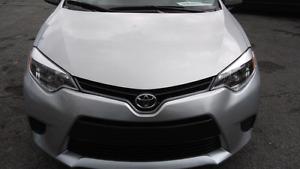 2015 Toyota Corolla LE . 2014 Mazda 3 GX Sky