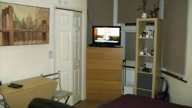 STUDIO FLAT WITH KITCHEN AND ENSUITE FULLY FURNISHED ON GROUND FLOOR