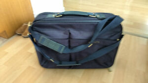 Suitcase 22 inches wide by 15 inches high very good condition