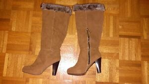 suede high heeled boots.