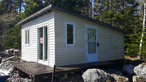 WATERFRONT CAMP ON PRIVATE DEEP COVE ON LAKE CHARLOTTE