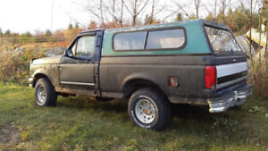 1994 f 150 ford  4x4 with cap ,