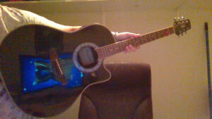 Sell this  acustic  guitar with tuner and case
