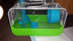 Small pet cage with accessories and food.