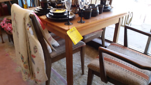 1/2 price slide out teak table reg 195 now 100.