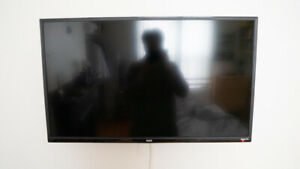 32 inch TV, nearly new, comes with box and adjustable wall mount
