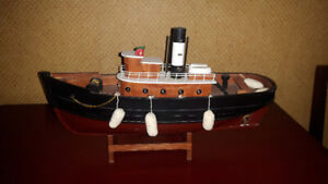 COLLECTABLES TUG BOAT  WITH STAND.