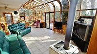 Estate Style Home Complete With Solarium!