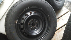4   ( 15 inch )  rims and tires for Toyota Corolla
