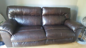 Leather couch and wedge chair with footstool