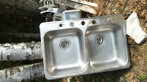 Stainless steel Kitchen sink $175 stoppers included.