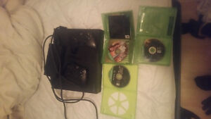 1TB Xbox one with 2 controllers and 4 games.