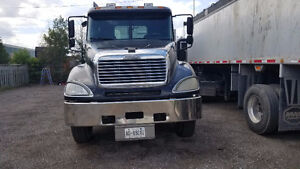 day cab Columbia with custom 2004 3 axle end dump trailer