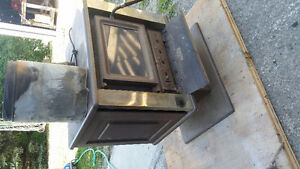 Free standing wood stove with fan
