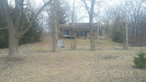 7 acres country property on river