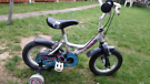 Small Bike with stabilisers in good condition