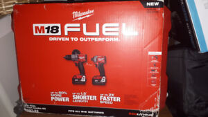 New in box 18v  Milwaukee fuel impact and hammer drill set