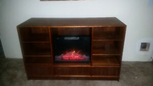 Custom made entertainment fire place in walnut