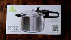 New in box pressure cooker