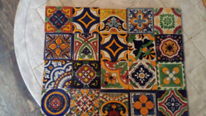 Set of 100 Mexican ceramic tiles.