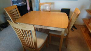 Free table with 4 chairs. Like new!