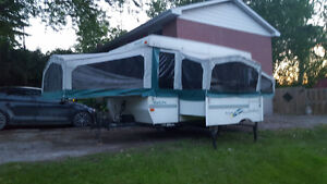 Pop up tent trailer with slideout