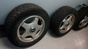 mags with winter tires. 225 60 16 / impala, buick etc
