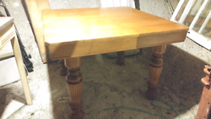 Solid Antique Dining Table with two leaf inserts.