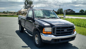 Ford F-350 Diesel avec Tommy Gate