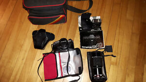 Olympus OM10 SLR camera with telephoto lense and filters